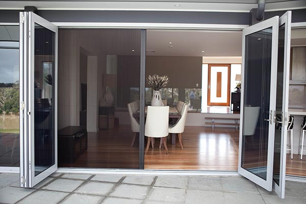 Screens for aluminium doors southern star group for Accordion retractable screen doors