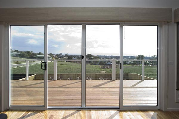 Screens for timber doors southern star group for Double sliding screen door